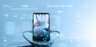 mobile phone with healthcare provider on screen with a stethoscope connected to the phone