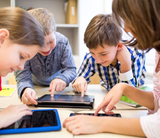 children in school learning with AI and technology