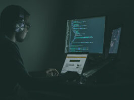 man on computer protecting business with cybersecurity