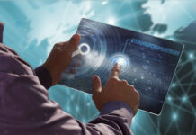 man using a virtual tablet to innovate and begin digital transformation