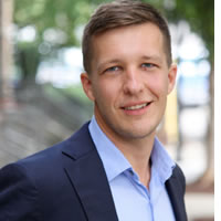 Headshot of Founder and CEO Alex Feiszli