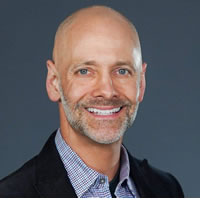 Headshot of Chief Executive Officer Ken Fine