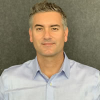 Headshot of Founder and CEO Elias Guerra