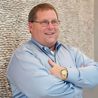 Headshot of Founder and CEO Dean Guida