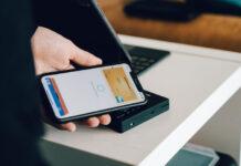 man using mobile wallet on phone or popwallet