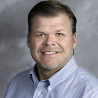 Headshot of Founder and CEO Michael Pink
