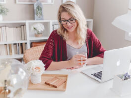 woman working from home on her laptop as her side hustle