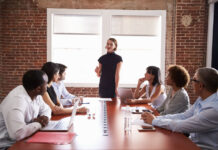 woman speaking in meeting about passion and goals