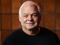 Headshot of Founder and CEO John Acres