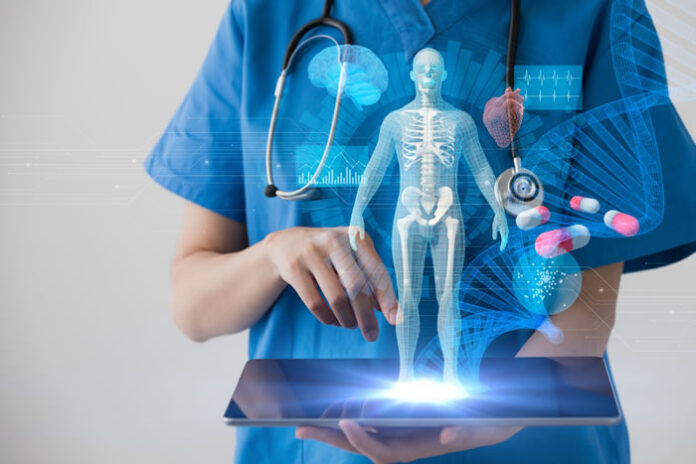 physician holding a tablet displaying a 3d image of human body