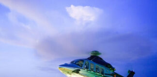 innovations in aviation technology with a helicopter landing on a helopad