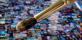 traditional paintbrush going over digital art on a tablet representing NFT art