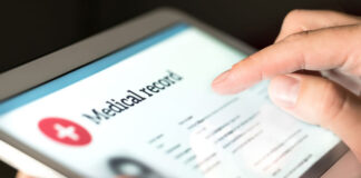 medical provider looking at patient data on a tablet