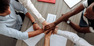 employees collaborating around a work table for staff augmentation