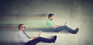 two floating men on laptops sitting like they are in race cars testing their website SEO speed