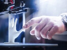 benefits of 3D Printing showing printer with human hand