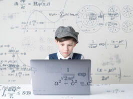 intent boy learning on laptop in ed tech