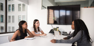 three diverse women interviewing and recruiting