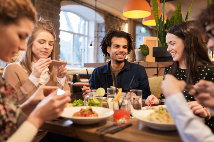 group of young adults gathering for indoor dining