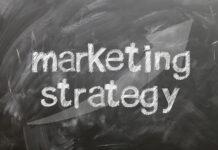 words marketing strategy written on a chalk board