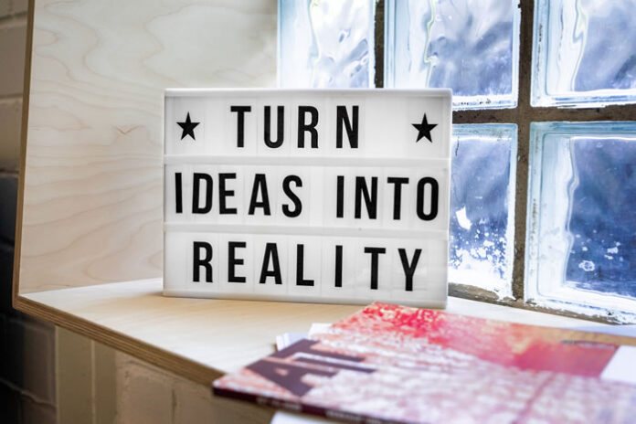 startup company with a sign for turning ideas into reality