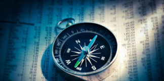 compass sitting on a financial planning document